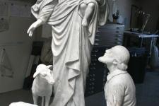 restoration of plaster Madonna