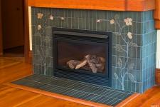 handmade art tile fireplace