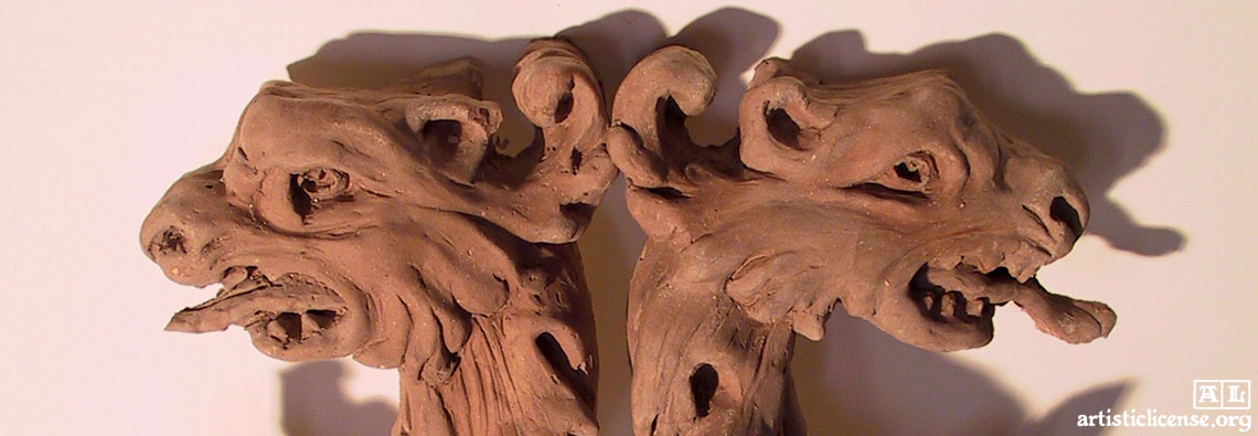 sculpted dragon elements for a Gothic mantel